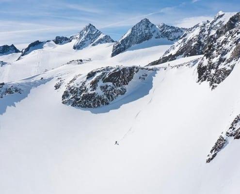 Off piste skier freeriding in backcountry of Stubai Glacier ski area
